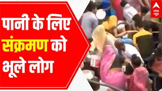 Delhi: People violate social distancing norms while filling water from tanker - ABPNEWSTV