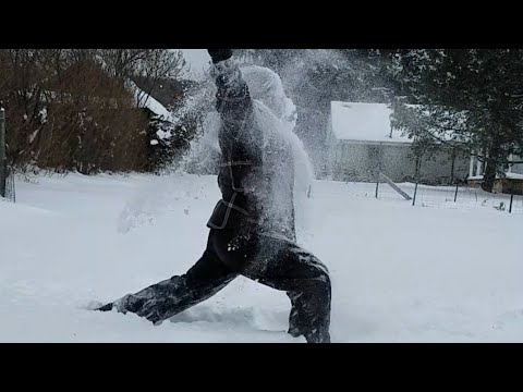Man Performs Yoga Poses Comically in Thick Snow