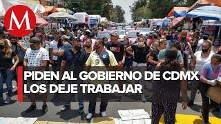 Comerciantes ambulantes protestan en Eje 1 Norte