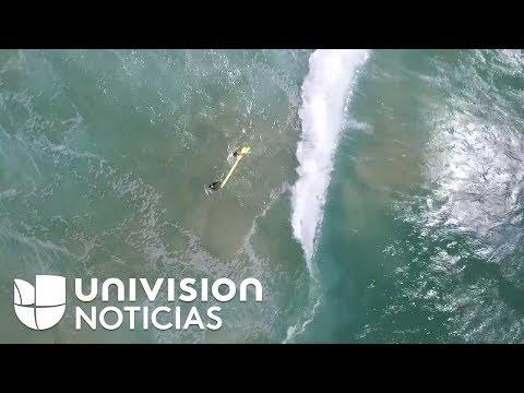 connectYoutube - Así rescató un dron a dos jóvenes atrapados en las olas de una playa australiana