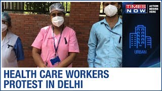 Health care workers wear black ribbon & protest against order to withdraw quarantine facility - TIMESNOWONLINE