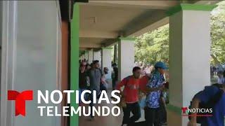Migrantes hondureños rompen la barrera de seguridad y entran en Guatemala   Noticias Telemundo