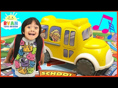 The Wheels on the Bus go round and round song board games for kids Kinder Eggs