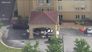 Police investigating after man and woman shot at Country Hearth Inn in Union City