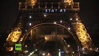 Proyectan mensajes en la Torre Eiffel que piden 'quedarse en casa'