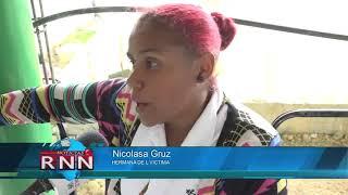 Familiares de joven muerto en Guaricano acusan a policía del hecho