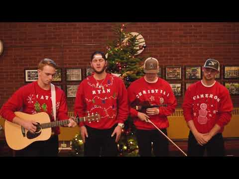 Baseball players singing O Holy Night