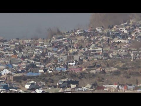 Rare footage shows people walking inside last IS-held territory in Syria's Baghouz