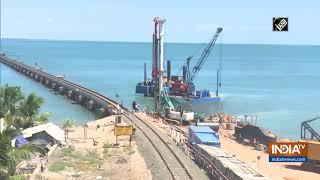 Construction of Indian Railways' first vertical lift rail bridge underway in Rameswaram - INDIATV