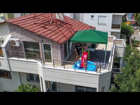 Sıcağı gören Antalyalılar, teras ve balkonlara şişme havuz kurdu