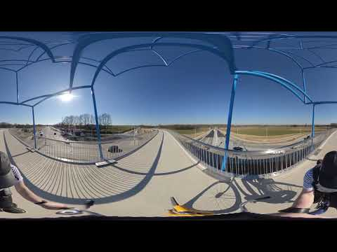 Cycling on the new cycle bridge at Schinveld (mun. Beekdaelen in the Netherlands) photo