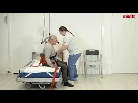 Lift from a bed to a toilet chair with ceiling hoist Molift Air