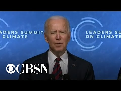 Biden pledges to cut emissions by at least half as he opens global climate summit
