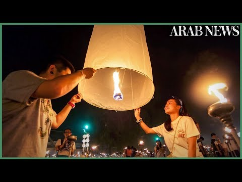 Sky glitters as lanterns released at Thai festival
