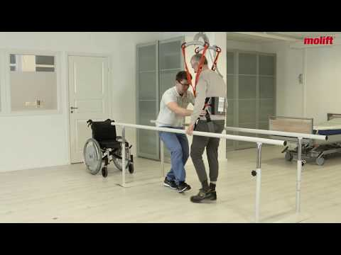 Perform assisted gait training with a ceiling hoist