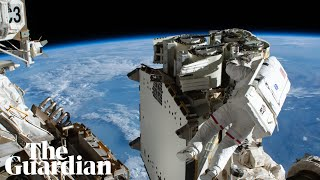 Earth emerges from shadow in Nasa time lapse of astronauts installing solar panels