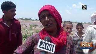 SDRF rescues woman stuck in flash floods in Jammu - INDIATV