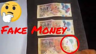 FAKE $50 BILL THE BOTTOM ONE FAKE Trinidad