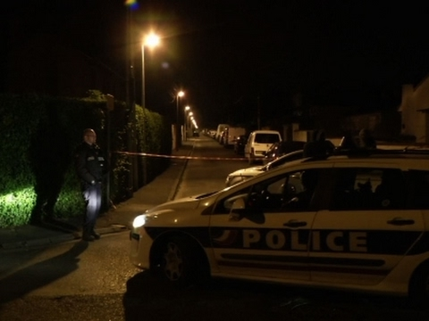 Raw: Police Raid Home After Paris Shooting