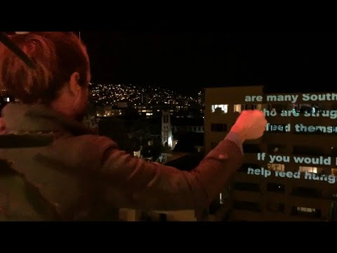 Cape Town residents use projector to promote charities during lockdown | AFP photo