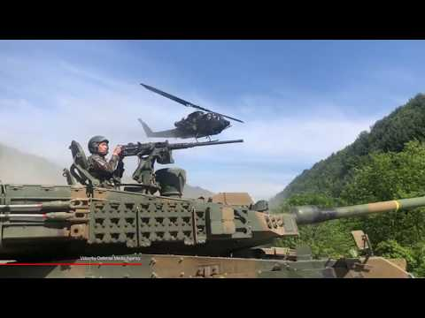 Republic of Korea Army AH-1S Cobra helicopters provide air cover for K2 Black Panther tanks