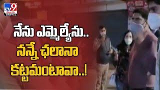 Uttarakhand Fined for not wearing mask, BJP MLA throws money at police officer - TV9 - TV9