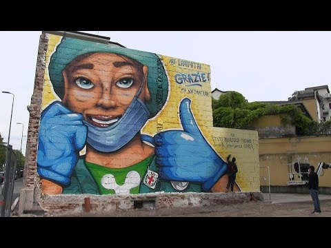 Street artist paints mural to thank doctors and nurses in Milan | AFP photo