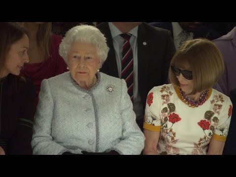 Queen Elizabeth II Takes in Fashion Show with Anna Wintour