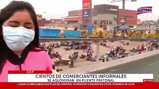 S.M.P: Cientos de comerciantes informales se aglomeran en puente peatonal