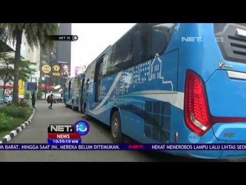 Harga Tiket Bus & Parkir Mobil Turun 50% - NET 10