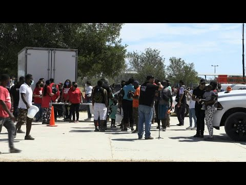 Migrants receive supplies from volunteers at camp on Mexico-US border | AFP