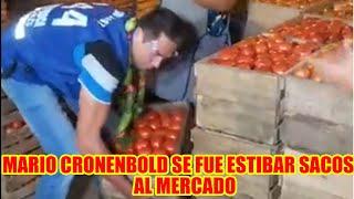 MARIO CRONENBOLD CARGANDO CAJONES DE TOMATES EN EL MERCADO...