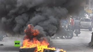 Enfrentamientos entre manifestantes y Policía en Haití por la gestión de covid-19 del Gobierno