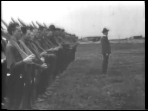 Newsreel footage captures headlines of war and early troop training. Film courtesy of the National Archives and Records Administration.