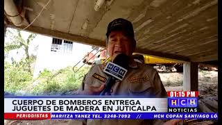 """¡Loable gesto! Tras su jornada laboral, bomberos construyen y obsequian bonitos """"carritos"""" de madera"""