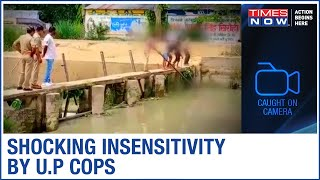 CAUGHT ON CAMERA: U.P cops force four children to bring out decomposed body from canal - TIMESNOWONLINE