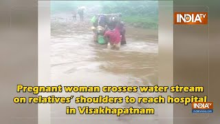 Pregnant Woman Crosses Water Stream On Relatives' Shoulders To Reach Hospital - INDIATV