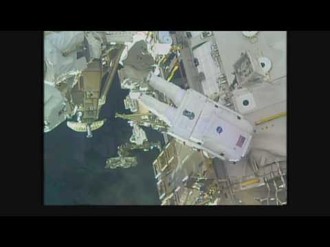 Space Station Crew Members Conduct a Spacewalk for…