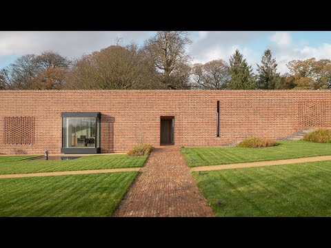 Linear brick wall conceals earthy and tactile interiors of Devon Passivhaus