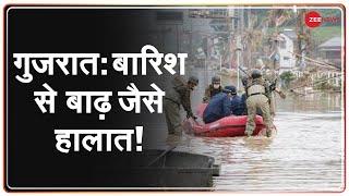 Gujarat के Jamnagar में भारी बारिश से बाढ़, कई जानवर पानी में बहे   Gujarat Floods   India - ZEENEWS
