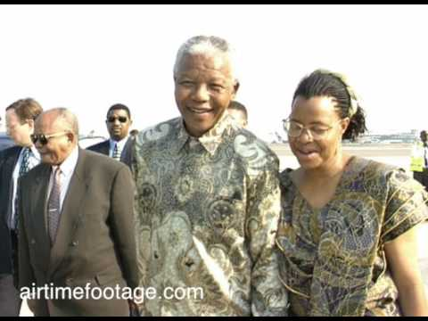 Airtime footage. Nelson Mandela hand in hand with Grace Machel