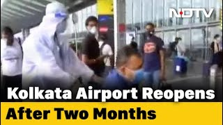 Airline Staff In Protective Gear Wheel Out Passengers At Kolkata Airport - NDTV