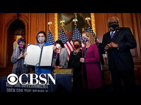 Congress passes bill to avert government shutdown as Democrats battle over Biden's agenda