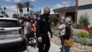People in masks line up for Calif. casino opening
