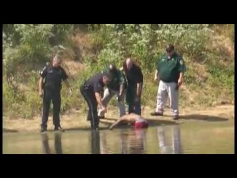 Suspect caught after jumping in river