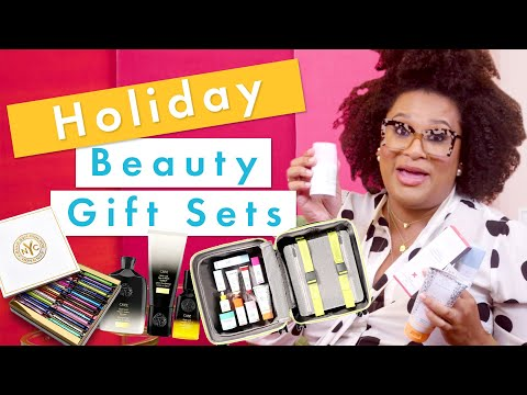 Unboxing and Reviewing Beauty Gift Sets! | Holiday Beauty Haul with Julee Wilson | Cosmopolitan