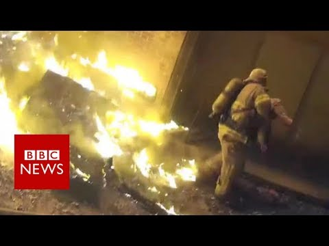 connectYoutube - Miracle catch: Firefighter catches child from burning building - BBC News