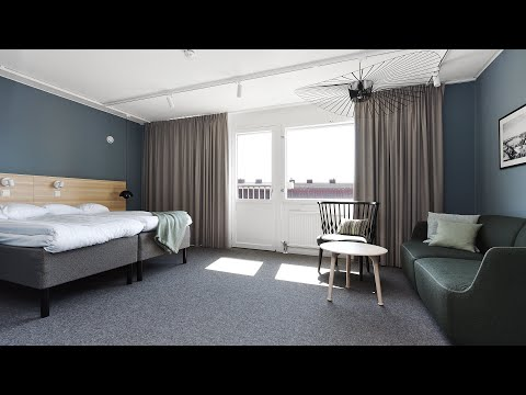 Direktorsrum som dubbelrum på Ersta konferens & hotell med utsikt över takåsarna