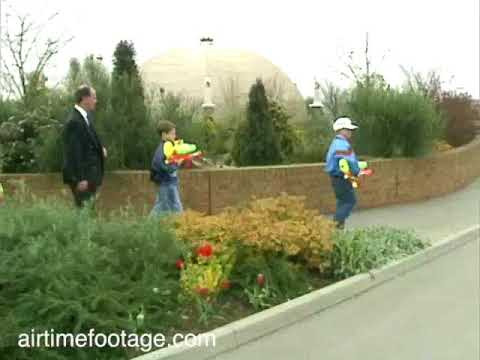 Princes William and Harry with waterguns - rushes