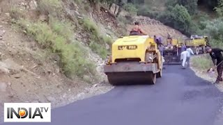Resumption of road construction work in JandK's Rajouri brings back employment to labourers - INDIATV